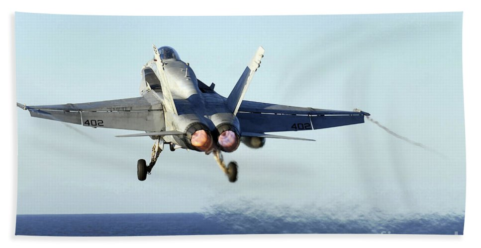 Afterburners Beach Towel featuring the photograph An Fa-18c Hornet Launches by Stocktrek Images