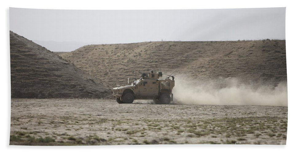 Kunduz Beach Towel featuring the photograph An M-atv Races Across The Wadi by Terry Moore