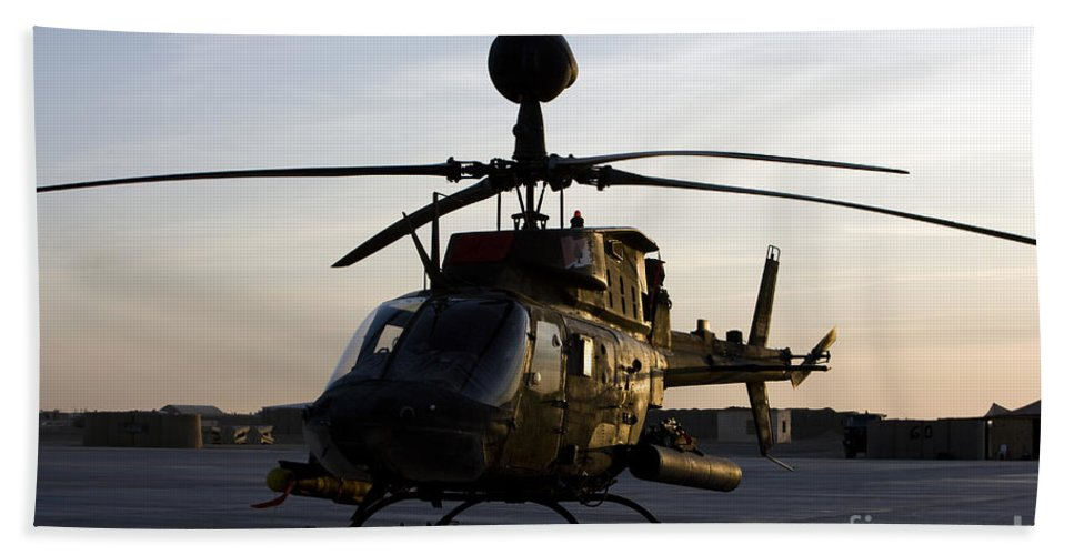 Aviation Beach Towel featuring the photograph An Oh-58d Kiowa During Sunset by Terry Moore