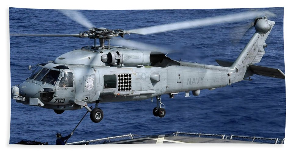 Color Image Beach Towel featuring the photograph An Sh-60b Seahawk Helicopter Performs by Stocktrek Images