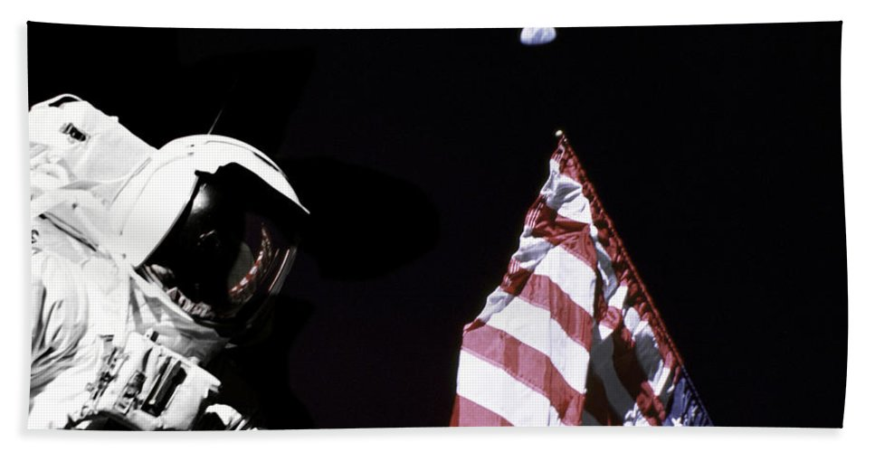 Color Image Beach Towel featuring the photograph Astronaut Stands Next To The American by Stocktrek Images