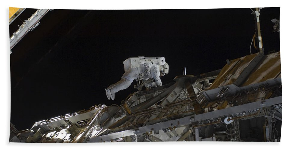 Sts-128 Beach Towel featuring the photograph Astronaut Working On The International by Stocktrek Images