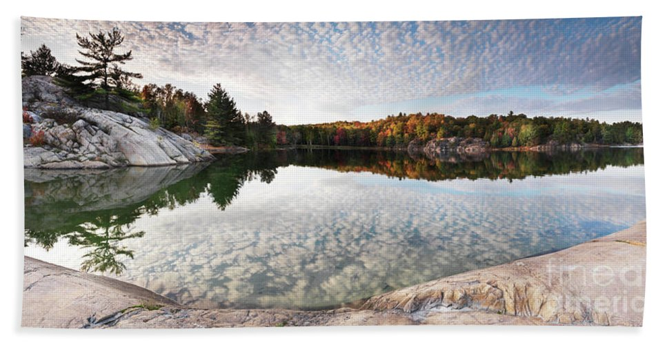 Lake Beach Towel featuring the photograph Autumn Nature Lake Rocks And Trees Panorama by Oleksiy Maksymenko