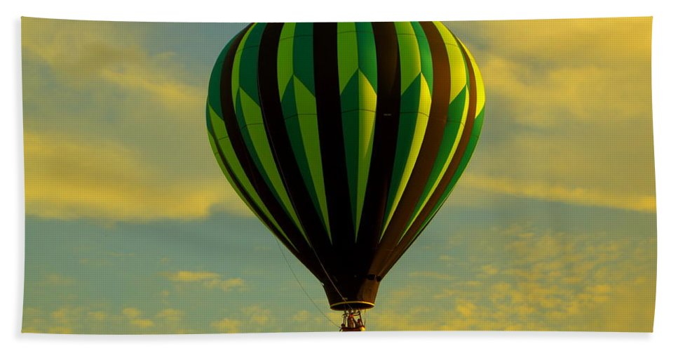 Balloon Race Beach Towel featuring the photograph Balloon Ride Through Gold Clouds by Robert Frederick