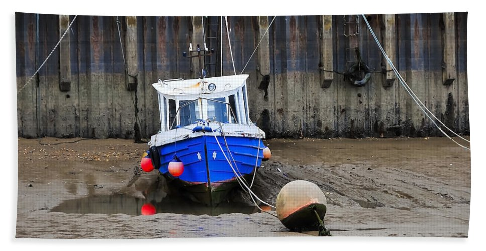 Anchored Beach Towel featuring the photograph Blue Small Boat by Svetlana Sewell
