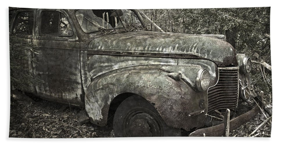 Rustbuckets Beach Towel featuring the photograph Camouflage Classic Car by John Stephens