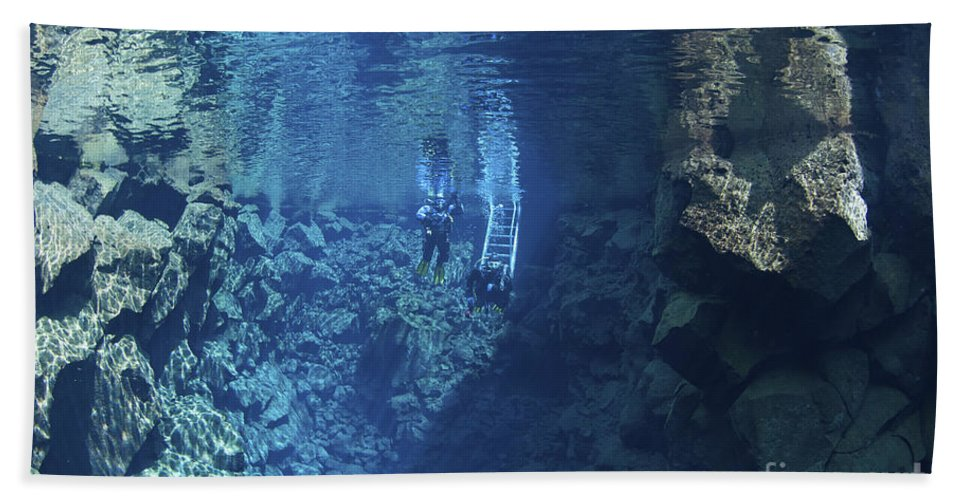 Diver Beach Towel featuring the photograph Dry Suit Divers Entering The Gin Clear by Mathieu Meur
