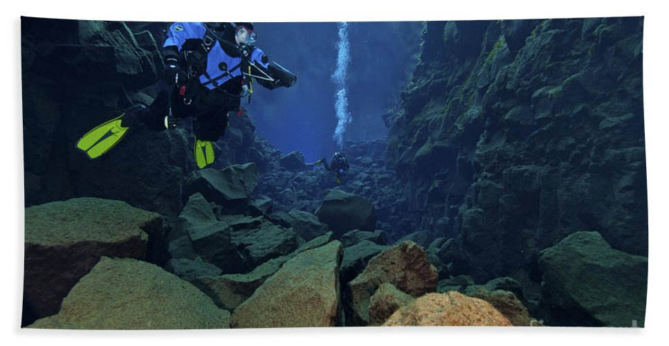 Silfra Crack Beach Towel featuring the photograph Dry Suit Divers In Gin Clear Waters by Mathieu Meur