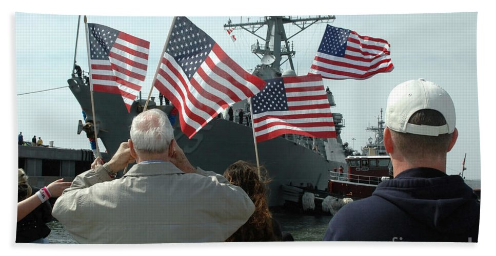 Color Image Beach Towel featuring the photograph Family Members Wave Flags To Show by Stocktrek Images