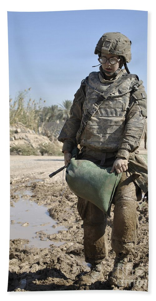 Carrying Beach Towel featuring the photograph Female Airman Carries A Sandbag by Stocktrek Images