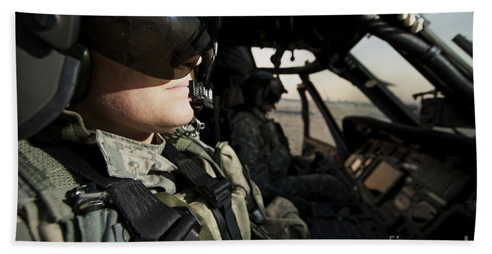 Helicopter Beach Towel featuring the photograph Female Pilot Commander In The Cockpit by Terry Moore