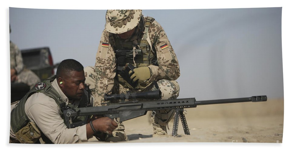 Operation Enduring Freedom Beach Towel featuring the photograph Fijian Contractor Clearing His Barrett by Terry Moore