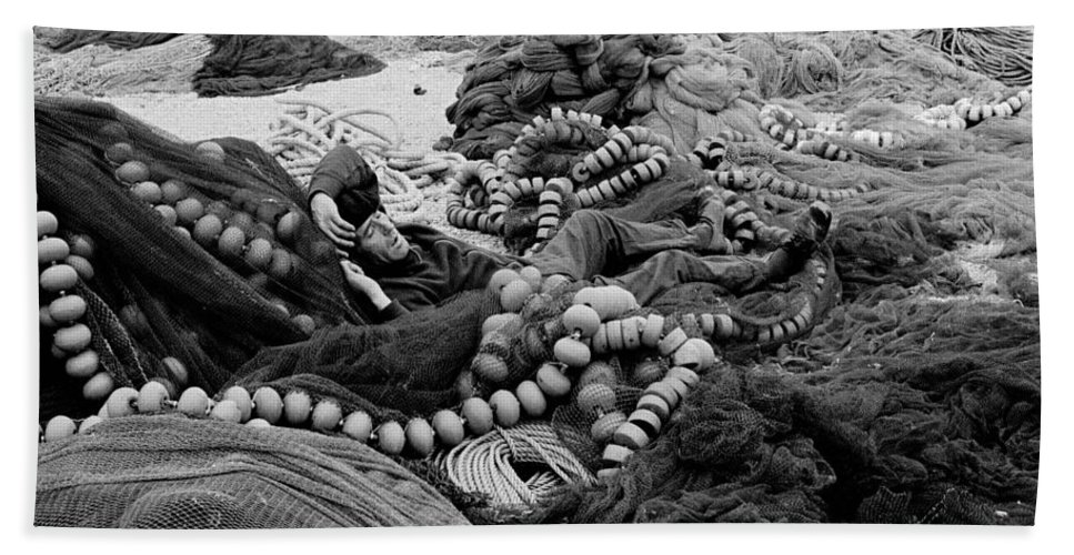 Fishing Nets Beach Towel featuring the photograph Fisherman Sleeping On A Huge Array Of Nets by Tom Wurl