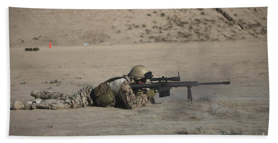 Sniper Beach Towel featuring the photograph German Soldier Firing A Barrett M82a1 by Terry Moore