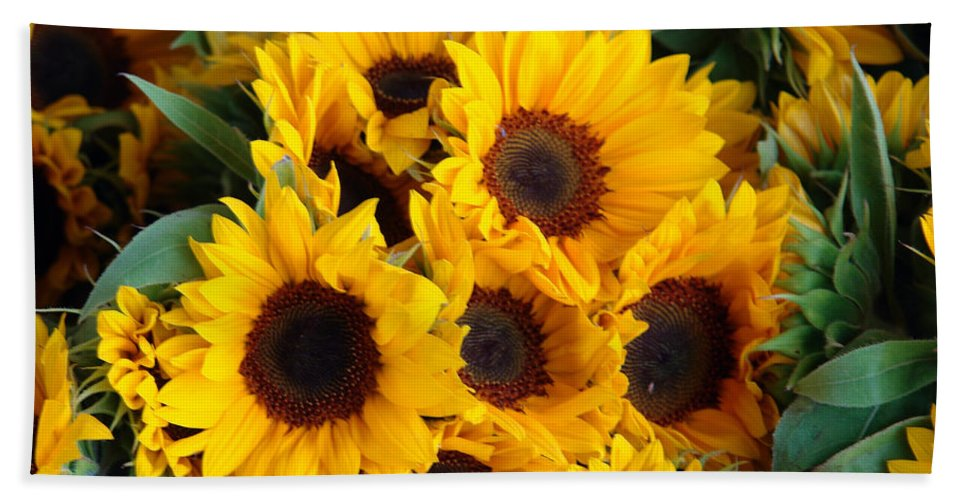 Flower Beach Towel featuring the photograph Giant Sunflowers For Sale In The Swiss City Of Lucerne by Ashish Agarwal