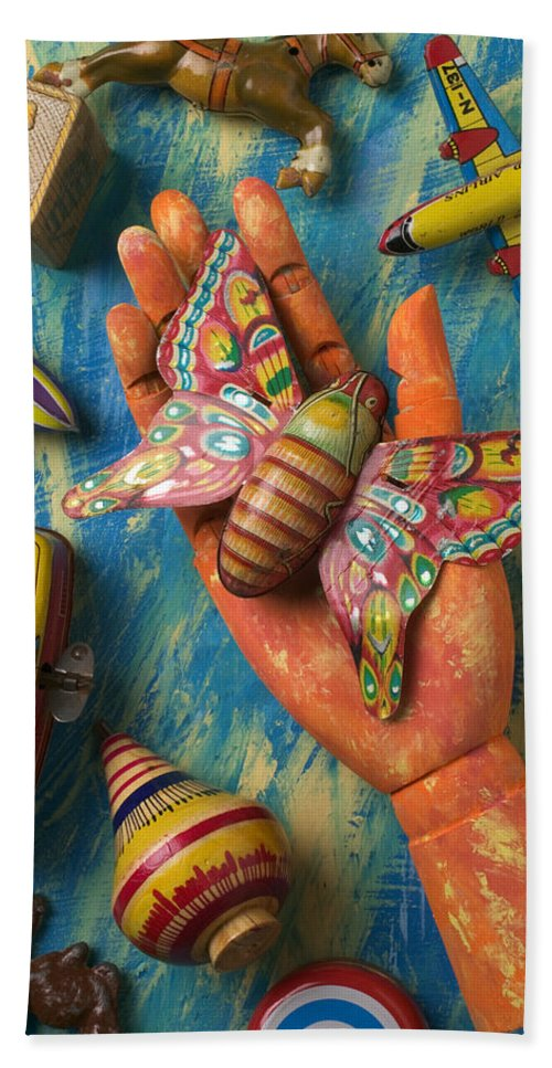 Wood Beach Towel featuring the photograph Hand Holding Butterfly Toy by Garry Gay