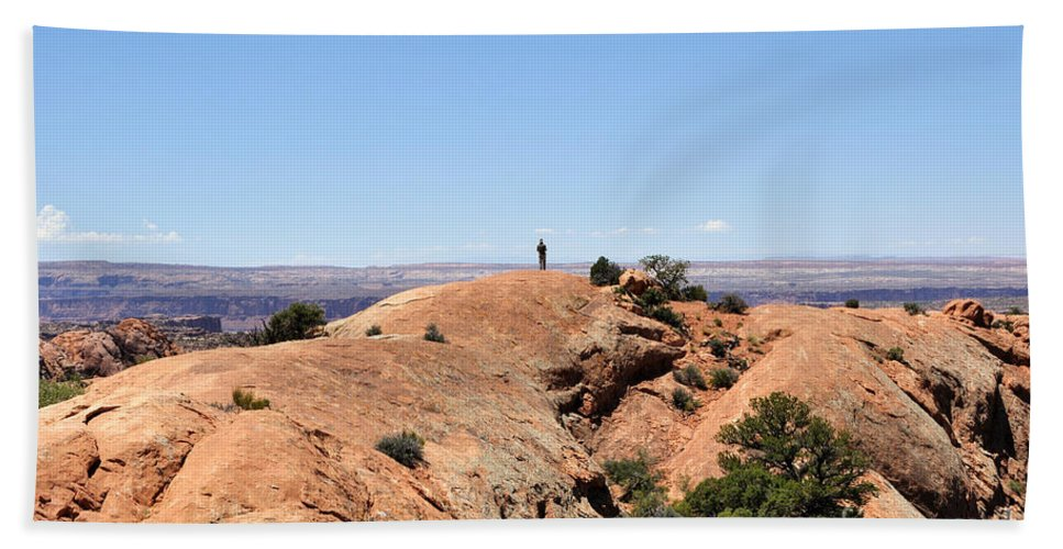 Upheaval Beach Towel featuring the photograph Hiker At Edge Of Upheaval Dome - Canyonlands by Gary Whitton