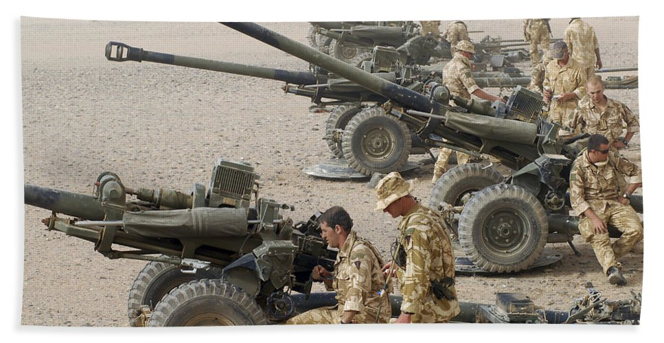 Armament Beach Towel featuring the photograph Howitzer 105mm Light Guns Are Lined by Andrew Chittock