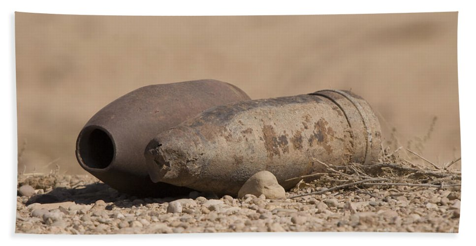 Disposal Beach Towel featuring the photograph Inert Artillery Rounds Litter Camp by Terry Moore