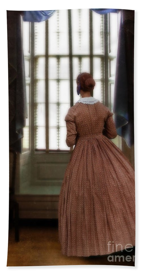 Window Beach Towel featuring the photograph Lady In 19th Century Clothing Looking Out Window by Jill Battaglia