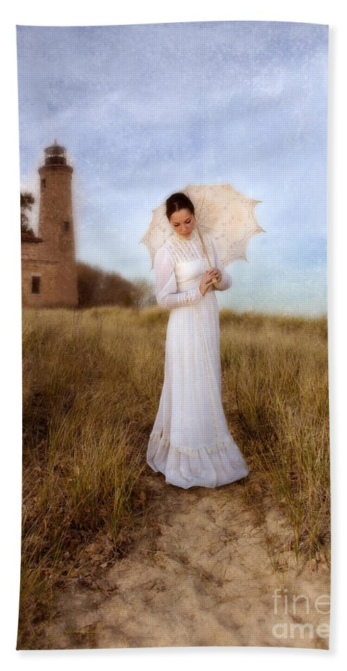Woman Beach Towel featuring the photograph Lady In White With Parasol By The Sea by Jill Battaglia