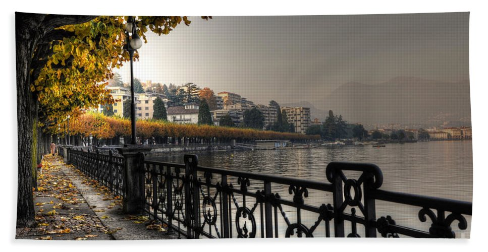 Lake Front Beach Towel featuring the photograph Lake Front With Autumn Trees by Mats Silvan