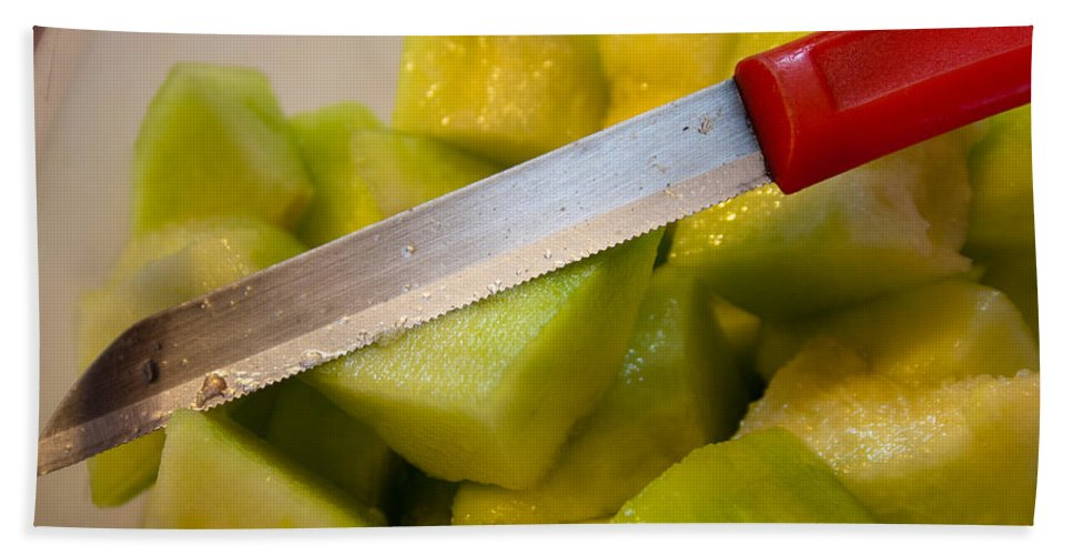 Fruit Beach Towel featuring the photograph Macro Photo Of Knife Over Bowl Of Cut Musk Melon by Ashish Agarwal