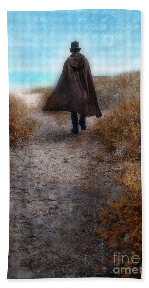 Man Beach Towel featuring the photograph Man In Cape And Top Hat By The Sea by Jill Battaglia