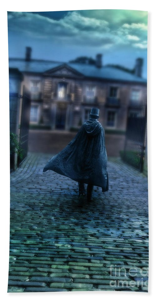 Man Beach Towel featuring the photograph Man In Top Hat And Cape On Cobblestone Street by Jill Battaglia