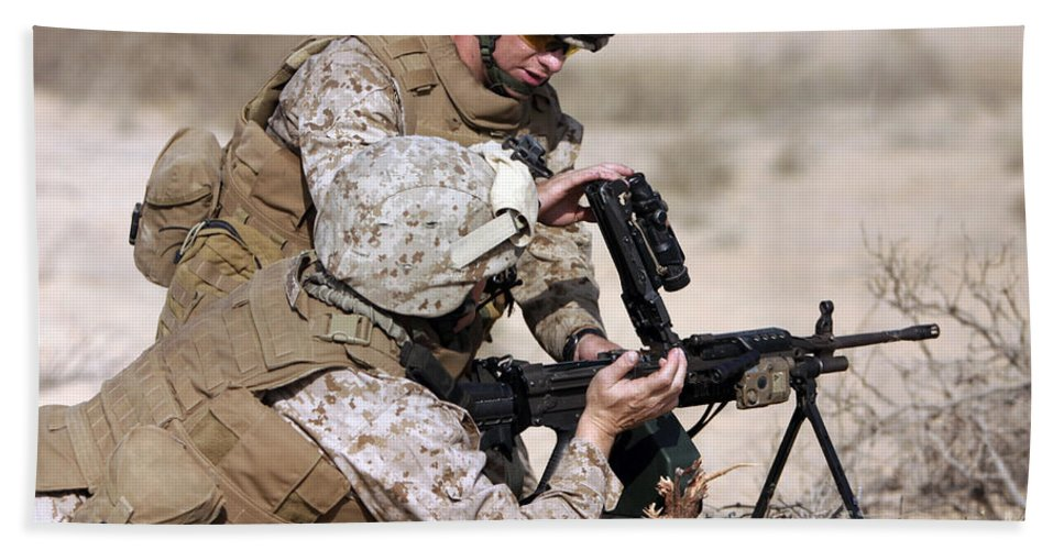 Military Beach Towel featuring the photograph Marine Gives Instructions On How by Stocktrek Images