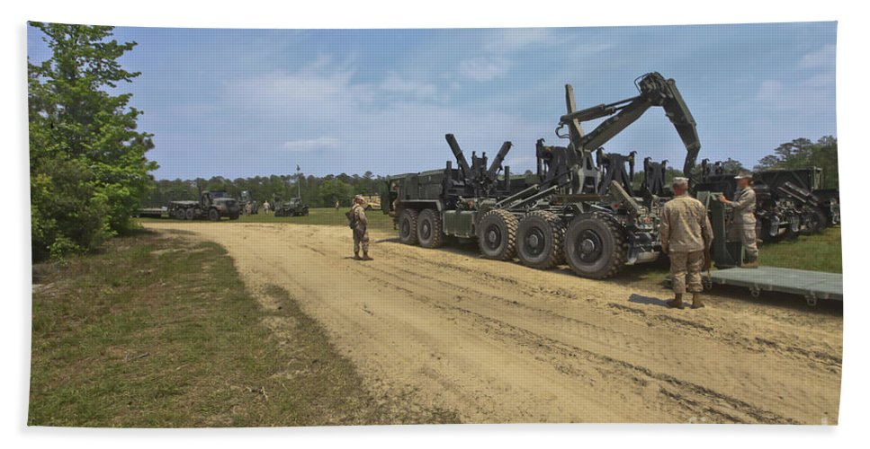 Horizontal Beach Towel featuring the photograph Marines Offload A Logistics Vehicle by Stocktrek Images