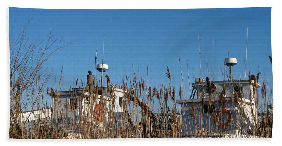 Oyster Boats Beach Towel featuring the photograph Oyster Boats In Dry Dock by Nancy Patterson