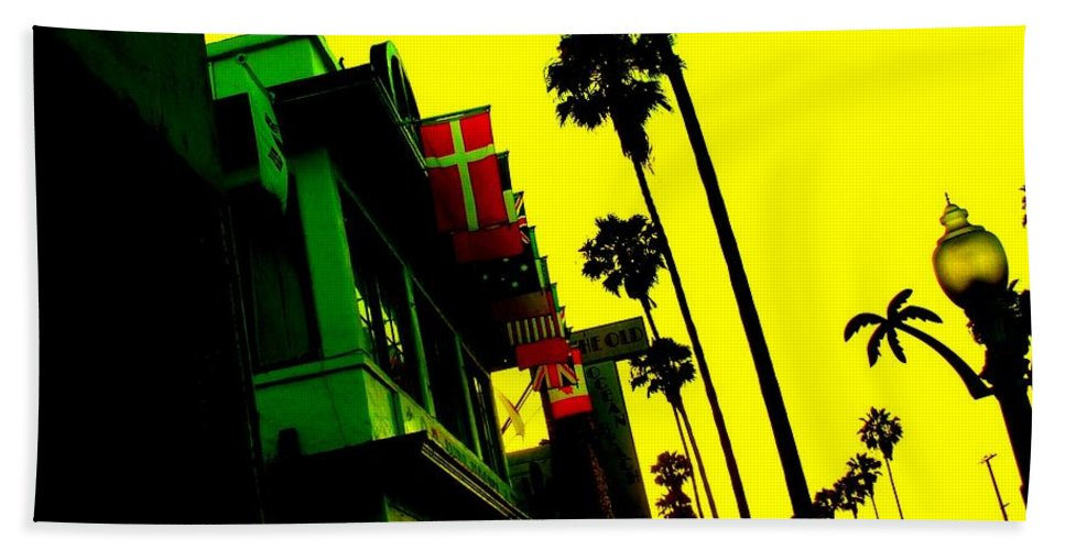 Palm Tree Sky Buildings Storefront Flags Beach Towel featuring the photograph Palm Tree Lane by Corey Maki