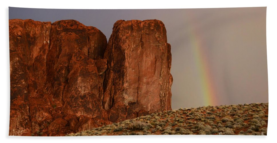 Sandstone Beach Towel featuring the photograph Rainbow And Red Rock by Bob Christopher