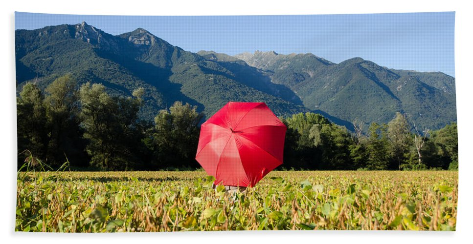 Red Beach Towel featuring the photograph Red Umbrella On The Field by Mats Silvan