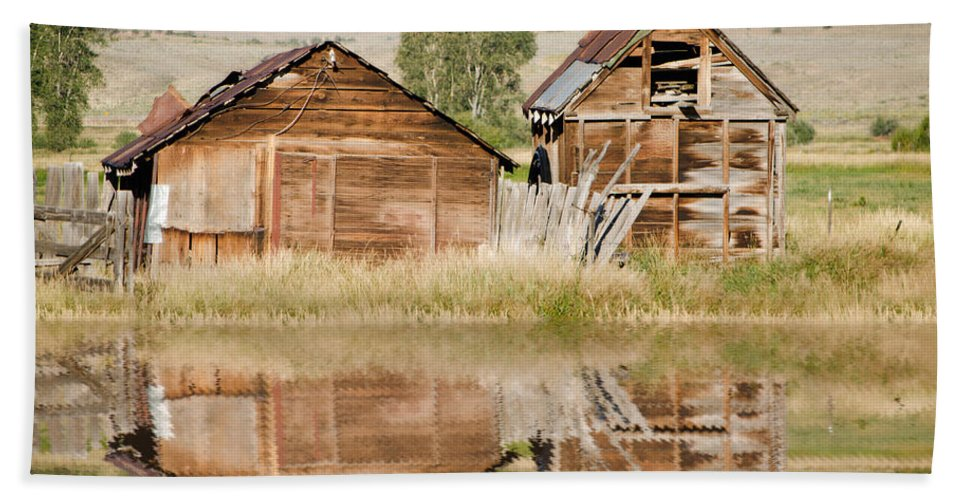 Fine Art Beach Towel featuring the photograph Reflection Of An Old Building by Donna Greene