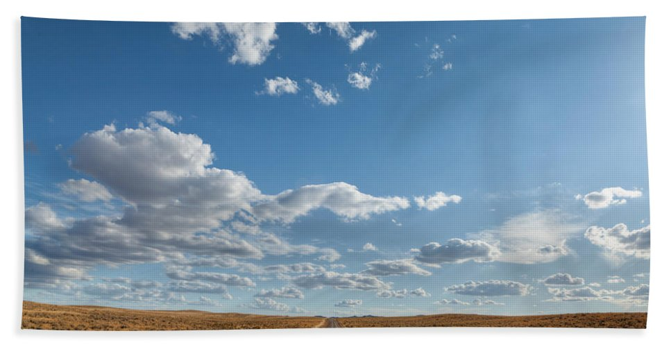 Desert Beach Towel featuring the photograph Road Near Ten Sleep Wyoming by Steve Gadomski