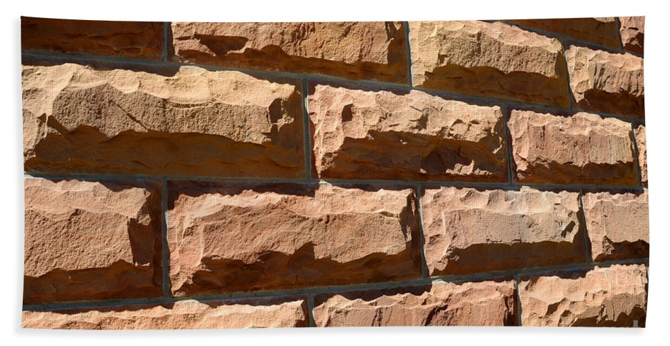 Sandstone Beach Towel featuring the photograph Rough Hewn Sandstone Brick Wall Of A Historic Building by Gary Whitton