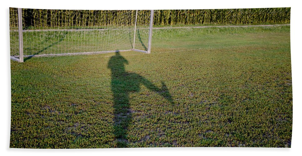 Football Beach Towel featuring the photograph Shadow From A Football Player by Mats Silvan