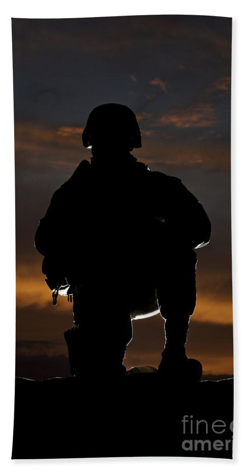 Marine Beach Towel featuring the photograph Silhouette Of A U.s. Marine In Uniform by Terry Moore