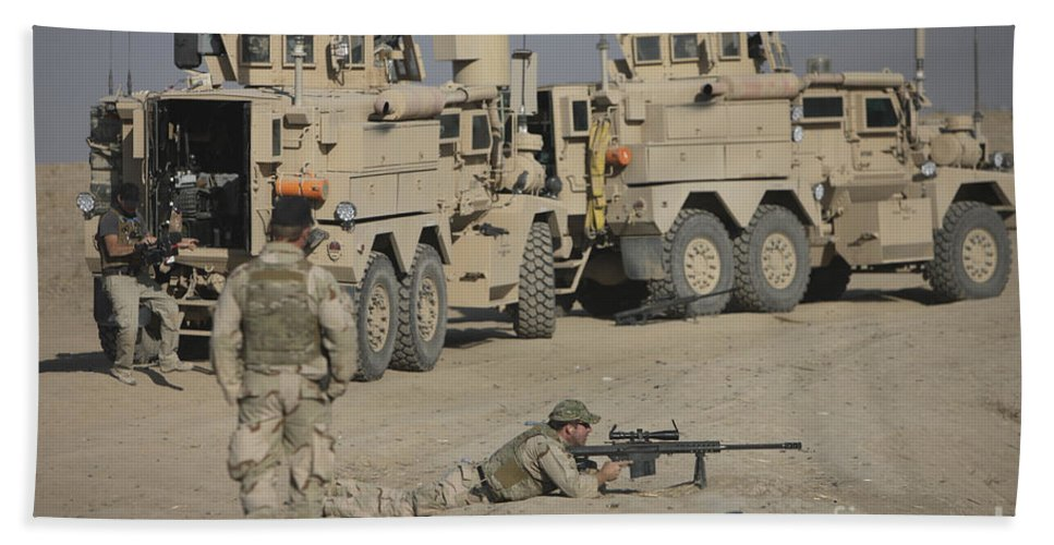 Vehicle Beach Towel featuring the photograph Soldier Fires A Barrett M82a1 Rifle by Terry Moore
