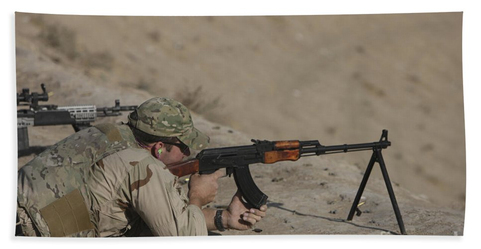 Us Navy Beach Towel featuring the photograph Soldier Fires A Russian Rpk Kalashnikov by Terry Moore