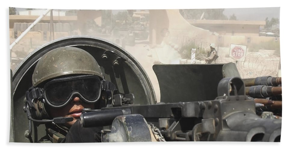 Color Image Beach Towel featuring the photograph Soldier Pulls Security From The Hatch by Stocktrek Images