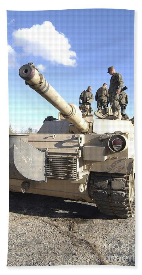 Vertical Beach Towel featuring the photograph Soldiers Get Their Battletank Ready by Stocktrek Images