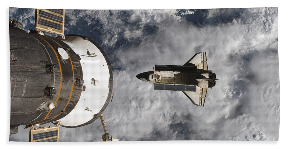Aerial View Beach Towel featuring the photograph Space Shuttle Atlantis And The Docked by Stocktrek Images