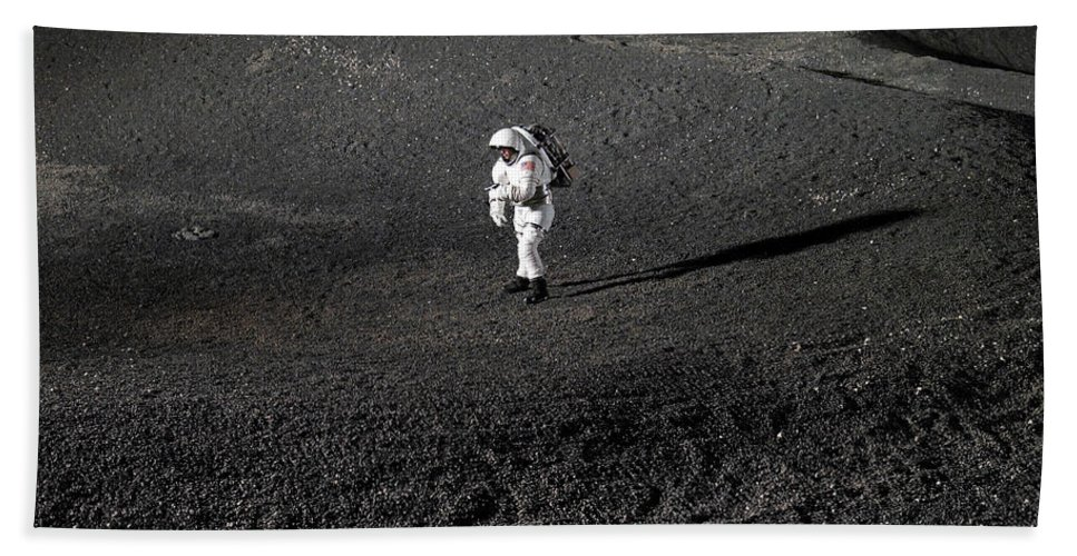 Research Beach Towel featuring the photograph Spacesuit Engineer Simulates Work by Stocktrek Images