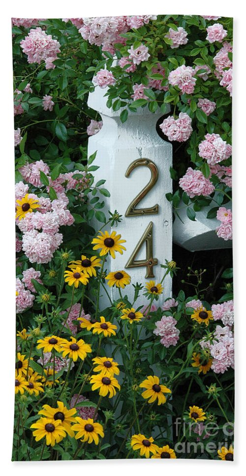 Spring Beach Towel featuring the photograph Spring Flowers And Fencepost by Mike Nellums