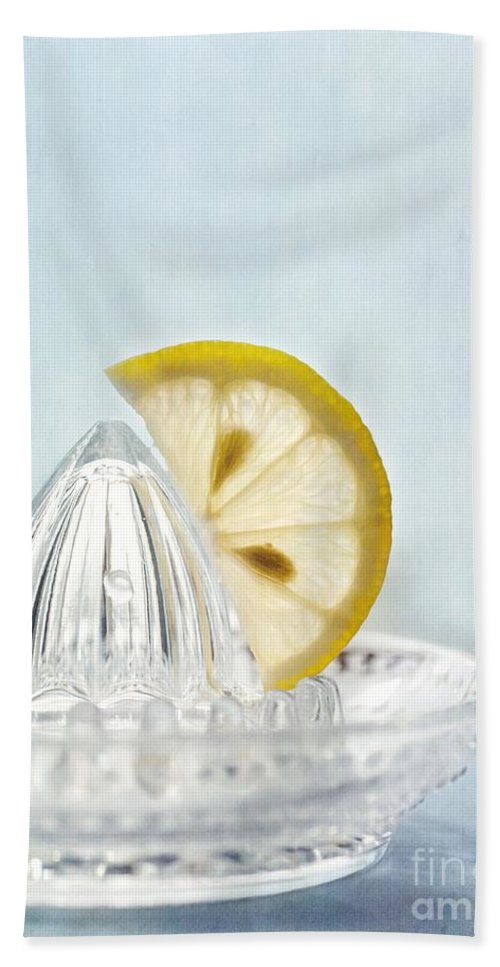 Lemon Beach Towel featuring the photograph Still Life With A Half Slice Of Lemon by Priska Wettstein