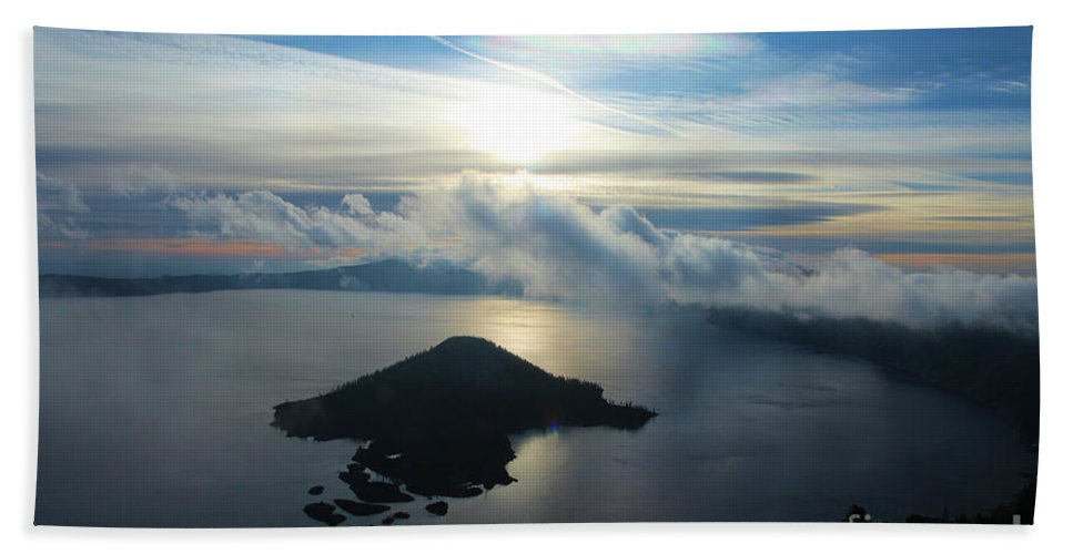 Crater Lake National Park Beach Towel featuring the photograph Streaks Above The Wizard by Adam Jewell