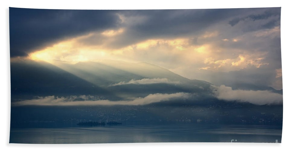 Sunlight Beach Towel featuring the photograph Sunlight And Clouds Over An Alpine Lake by Mats Silvan
